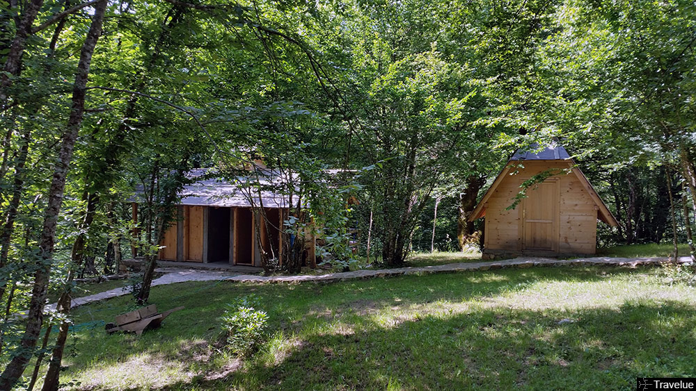 Wooden cabin and shared bath at Kamp Divlja Rijeka